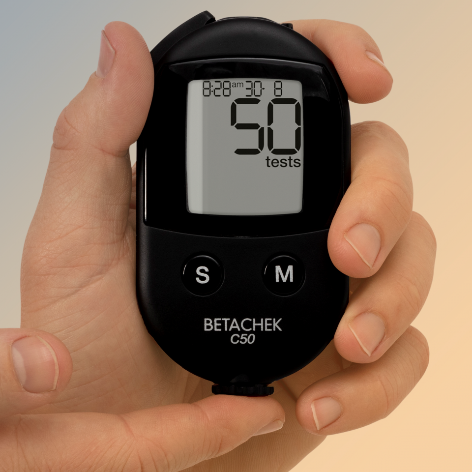 holding C50 Blood Glucose Meter